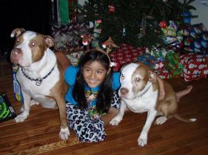 Happy granddaughter and grandpuppers on Christmas morning